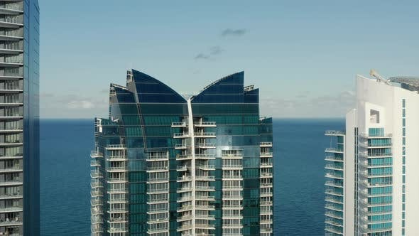 Thumbnail for Aerial Miami South Beach, Modern Wing-shaped Glass Roof Oceanfront Building