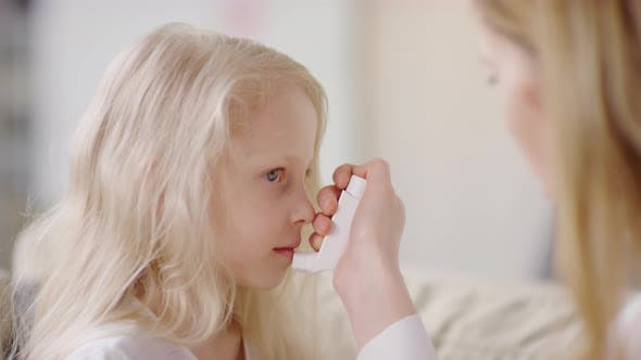 Thumbnail for Mother Giving Inhaler to Daughter with Asthma Attack