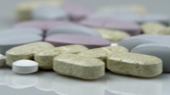 Panning shot across supplement pills.