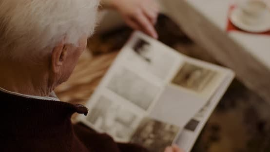 Thumbnail for Senior Man Looking At Photo Album During Christmas