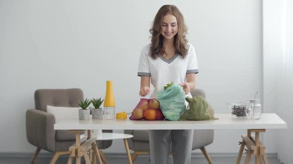Thumbnail for Young Cute Girl Preparing To Cooking a Salad. Vegetables and Fruits on the Table in a Cozy Kitchen