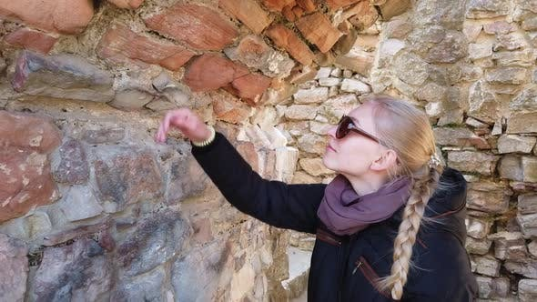 Thumbnail for Girl Inspecting the Walls of an Old Castle in Europe.