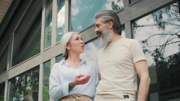 Thumbnail for Happy Elderly Couple Enjoying Nature and Talking