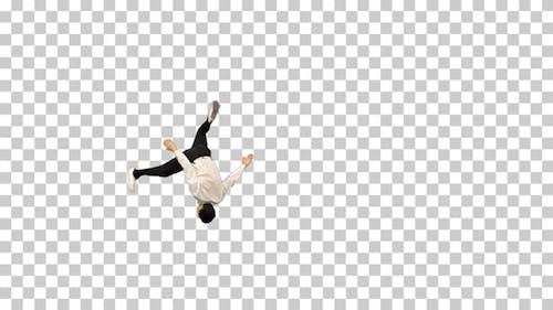 Young man in white shirt doing back flip, Alpha Channel