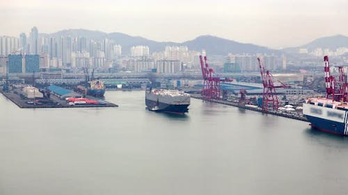 Timelapse Freighter Departs Incheon Port with Cranes