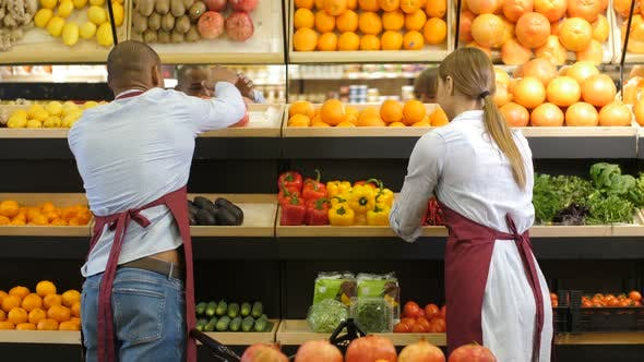 Thumbnail for Small Business Owners Arranging Groceries at Store