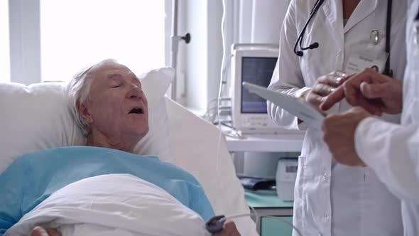 Thumbnail for Medical Doctors Using Gadget while Speaking with Elderly Patient