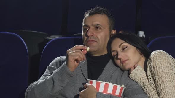 Thumbnail for Mature Man Shushing To the Camera Warching a Movie at the Cinema