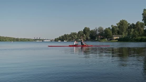 Thumbnail for Young Sports Team Two Teenage Boys with Double Boat Kayak