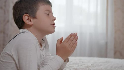 Trust in God, Prayer Male Child with Hope in His Heart and with Folded Together Arms, Prays To God