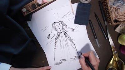 Clothes Designer Working on Fashion Sketch