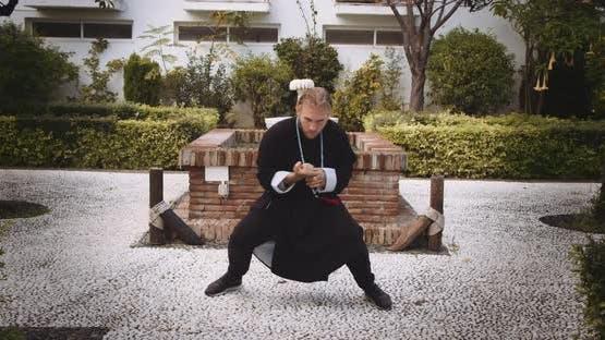 Man Performing Martial Arts In Garden