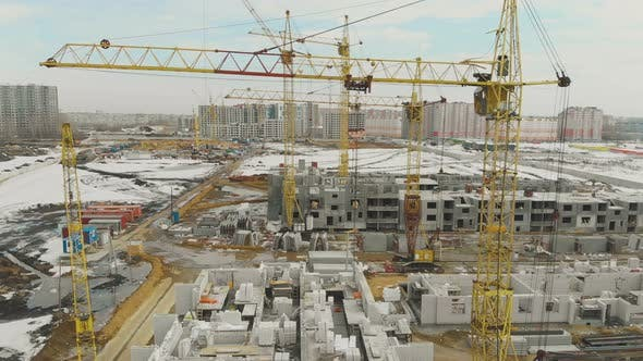Thumbnail for Motion Above Construction Site with Huge Yellow Cranes