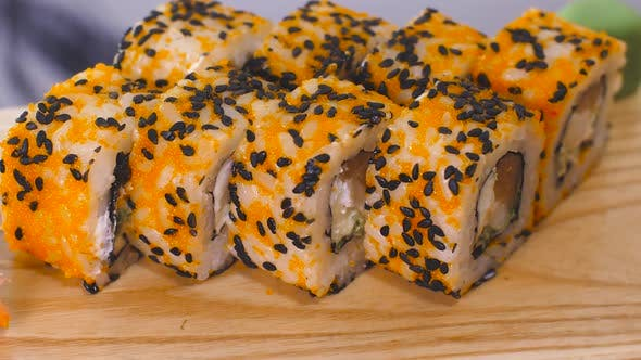 Sushi Rolls on Wooden Plate