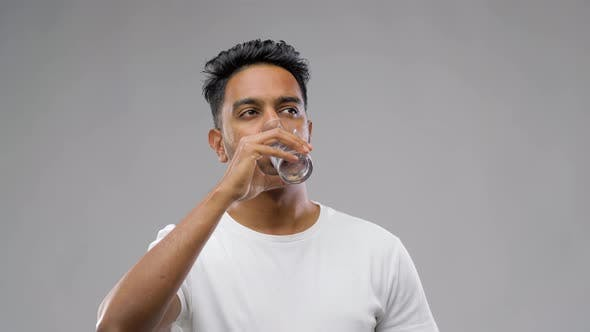 Happy Young Indian Man Drinking Water From Glass 37