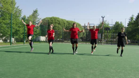 Thumbnail for Female Soccer Players Warming Up for Workout on Field
