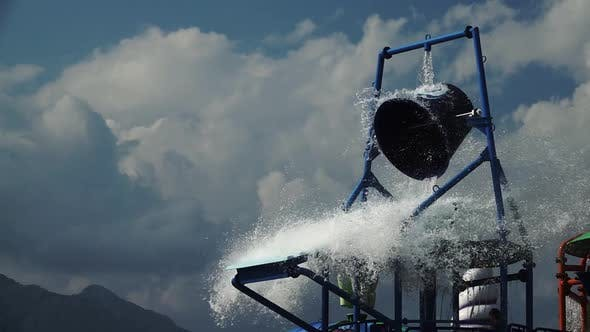 Thumbnail for Water Park a Bucket of Water Turns Over. Slow Motion. Close Up