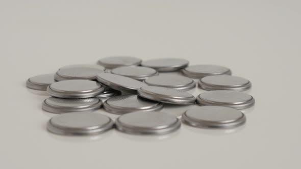 Thumbnail for Pile of button batteries slow tilt 4K footage