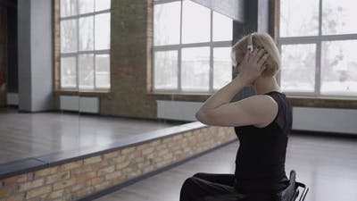 Disabled Woman in Headphones Dancing in Ballroom