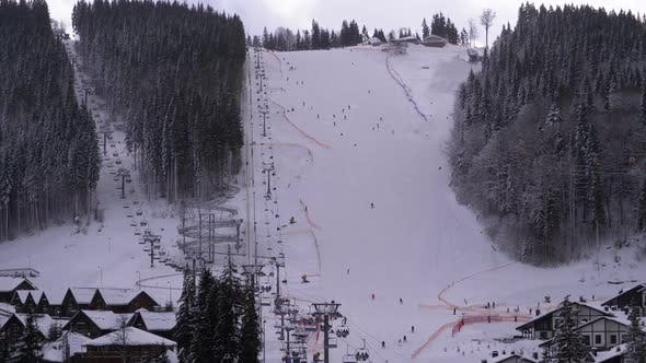 Thumbnail for Ski Resort. Skiers Ride on a Snowy Slope in Cloudy Day. Bukovel, Carpathians.