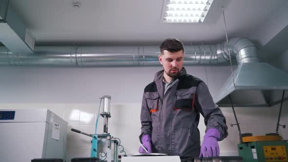 Thumbnail for a Man Works in a Lab