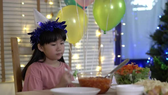 Child girl celebrating her birthday alone
