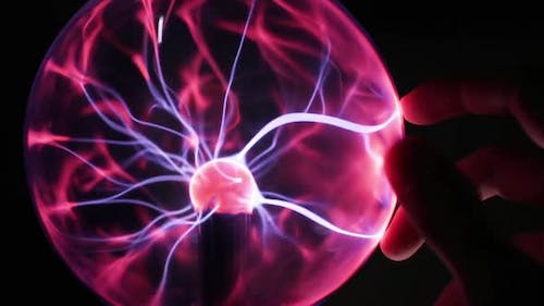 Hand Touching Plasma Lamp in the Dark Room Electrical Impulses Close Up