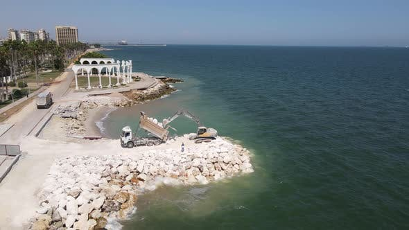 Construction Equipment Unloading Coastline Aerial