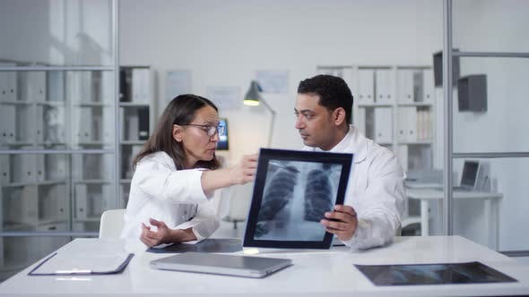 Doctors Working With X-Ray