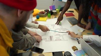 Creative Design Team Discussing Apartment Layout