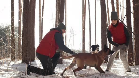 Thumbnail for Dog Owners Enjoying Walk in Forest