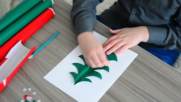 Thumbnail for Teen Boy Making Christmas Card