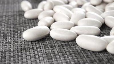 Raw white beans on a kitchen mat