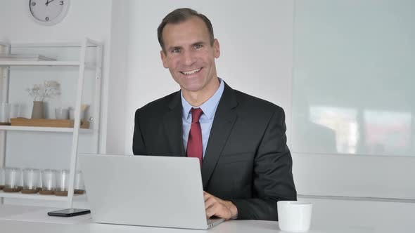 Thumbnail for Yes, Positive Middle Aged Businessman Accepting Offer By Shaking Head
