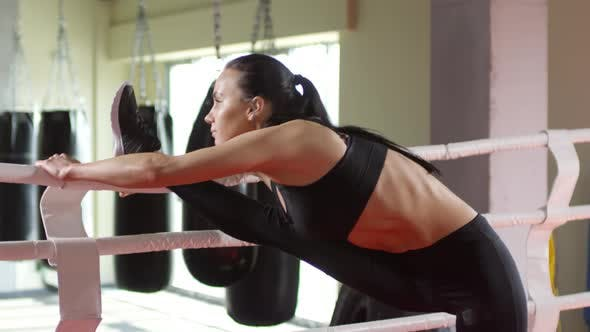 Thumbnail for Athletic Woman Stretching Leg in Boxing Ring