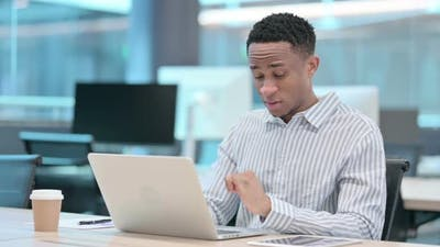 Young African Businessman with Laptop Having Wrist Pain