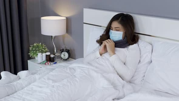 sick woman in medical mask feeling cold and coughing and suffering from virus disease