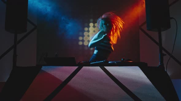 Thumbnail for Female Professional DJ Dancing and Playing Music