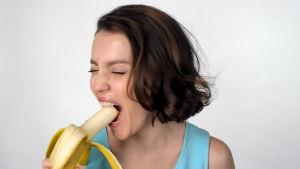 Cover Image for Happy Woman Eating Banana