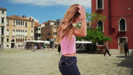 Thumbnail for Happy attractive female listening to music and dancing on Venice street