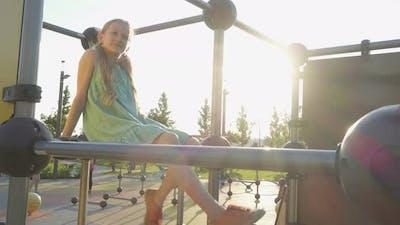 Child Girl Swinging The Legs 3