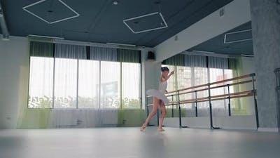 Girl in Tutu Dances Ballet in Studio