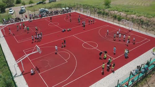 Aerial View of Young Athletes Playing Basketball on an Open Public Basketball Court