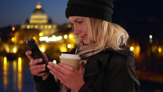 Thumbnail for Traveling Caucasian young lady on phone outside in Rome, Italy in the evening