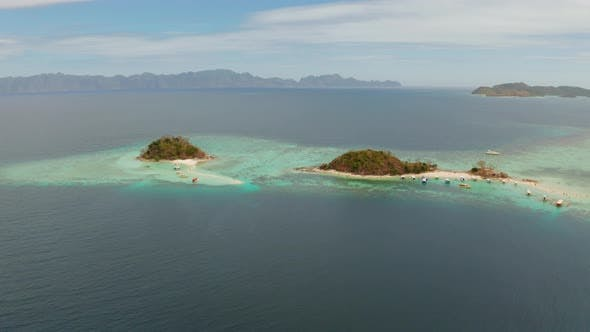Cover Image for Small Torpic Island with a White Sandy Beach, Top View