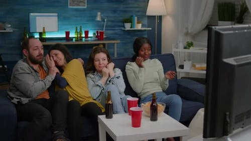 Multiracial Friends Screaming While Watching Thriller Movie