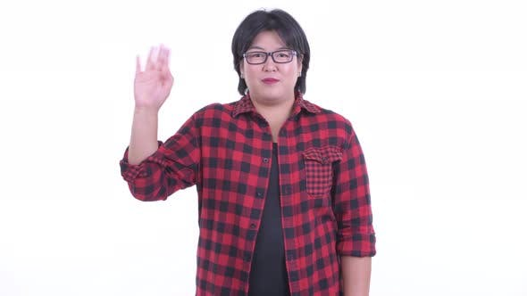 Thumbnail for Happy Overweight Asian Hipster Woman Waving Hand