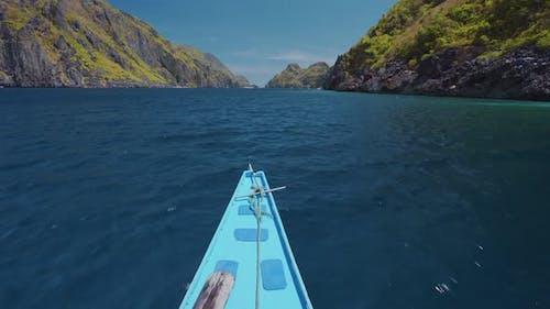 Island Hopping Tour Boat on Speed Passing Exotic Karst Limestone Strait on Travel Trip Exploring