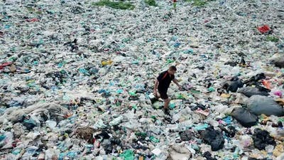 A man at a landfill. The concept of environmental pollution and environmental catastrophe.