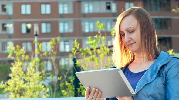 Thumbnail for Woman Using Tablet Computer Sitting on Bench in City